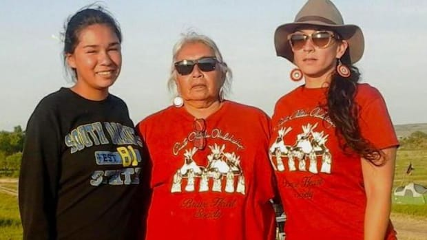Faith Spotted Eagle, Ihanktowan elder, with her granddaughter Mia and daughter Mahpiya.