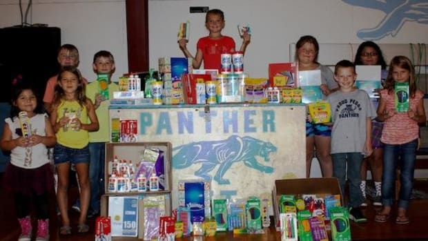 Students at Peggs Public School receive supplies collected and donated by CNB employee volunteers.