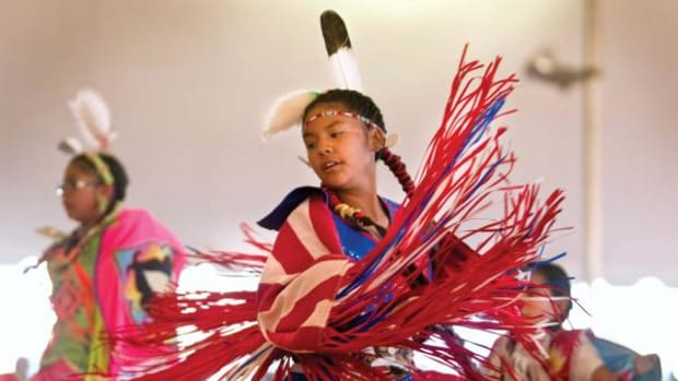 Fancy shawl dancer Veronica Toledo, center, of Farmington performs during the 44th Annual Western Navajo Fair Powwow, on Saturday afternoon, Oct. 20, 2012, in Tuba City. (Diego James Robles)