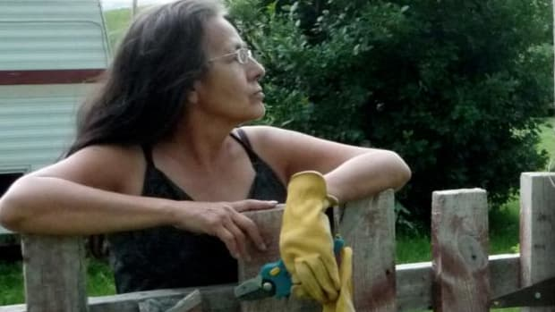 Debra White Plume watches an approaching storm. Photo by Suree Towfighnia