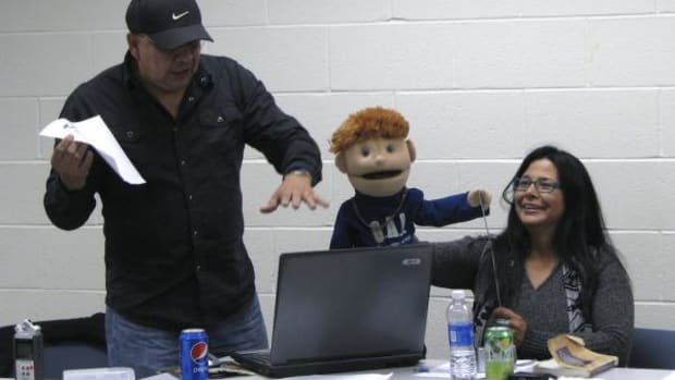 An Ojibwemowin speaking puppet (held by Susan Hallett) joined the group.