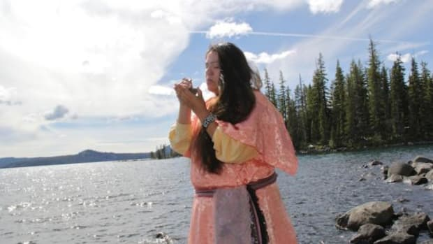Kayla Godowa-Tufti smokes tobacco June 22 on the shores of Waldo Lake, the ancestral homeland of her great-great grandfather and his people, the Chakgeenki-Tufti Band of the Mollalish. Located in the western slopes of the Cascades, Waldo Lake is believed to be one of the purest lakes in the world. Tufti was among several Oregon advocates who successfully lobbied the state to ban motorboats and floatplanes at the lake to protect its world-renowned water quality.