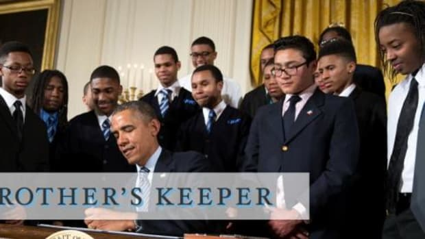 """President Barack Obama signs the My Brother's Keeper initiative. He said: """"That's what 'My Brother's Keeper' is all about. Helping more of our young people stay on track. Providing the support they need to think more broadly about their future. Building on what works—when it works, in those critical life-changing moments."""""""