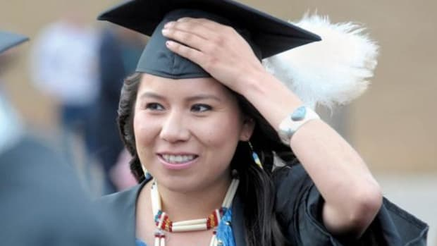 """I'm a pow wow dancer, so that's why I'm wearing my pow wow regalia, said Davonne Teri John, who is Navajo, shown here waiting in line before a recent graduation ceremony at Fort Lewis College."