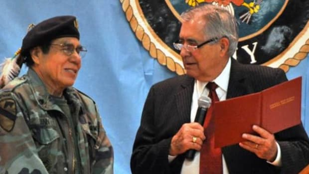 Cherokee artist and veteran Donald Vann was presented a high school diploma from his former Stilwell High School Superintendent Neil Morton 46 years after leaving school to enlist.
