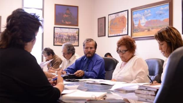 Navajo Technical University's GED/ABE program director Dr. Lawrence Isaac (center) discusses NTU's GED program with representatives from Navajo Nation Workforce Development on June 30, 2014 at NTU's main campus in Crownpoint, New Mexico.