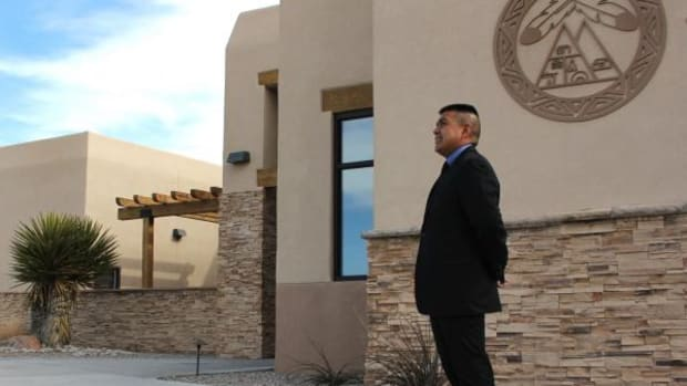 CEO Derek Valdo in front of AMERIND Risk's headquarters on the Santa Ana Pueblo in New Mexico. His higher mission is to create affordable and sustainable insurance products that foster economic development in Native communities.