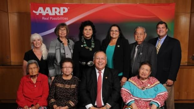 Muscogee Creek Nation Chief George Tiger, center, poses with Muscogee Creek Nation honorees at the 5th Annual AARP Oklahoma Indian Elder Honors. Front: Jeanetta Anderson, Mary Arkeketa, Chief Tiger, Pauline Haney. Back: AARP Oklahoma State President Marjorie Lyons, Johnnie Brasuell, Sandra Dacon Medrano, Mrs. Tiger, Keeper Johnson and AARP Oklahoma State Director Sean Voskuhl.
