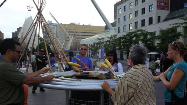 DIY elk hot dogs and ears of corn drew dozens of people to open fires on the Place des Festivals in Montreal for the First Peoples Festival, which runs through August 5.
