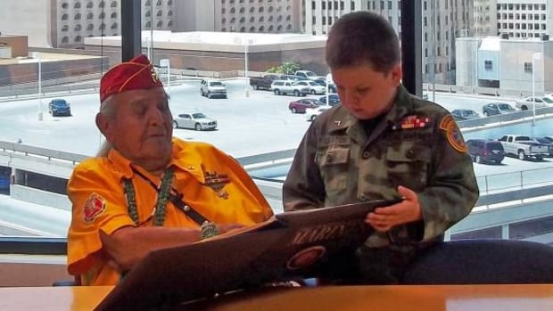 Joe Kellwood and great-grandson, Brian Relation in 2013. At the age of 8, Relation joined the Young Marines in 2012 because he wanted to be apart of an Organization that participated in the Navajo Code Talkers Events. Kellwood, a Navajo code talker, walked on September 5.