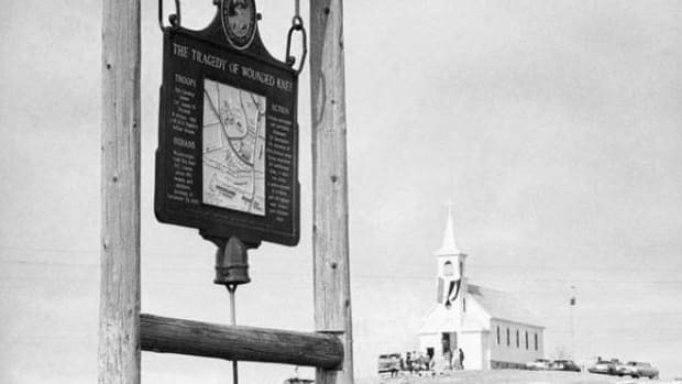 A historical marker commemorates the Wounded Knee Massacre of 1890 near Sacred Heart Catholic Church.