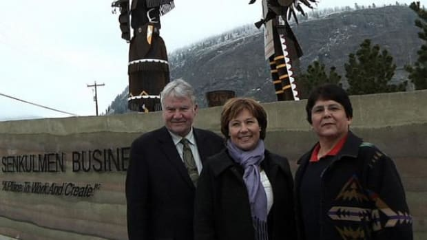 L-R, Boundary-Similkameen MLA John Slater, B.C. Premier Christy Clarke and Osoyoos CEO and Chief Clarence Louie stand in front of the Senkulmen Enterprise Park on Osoyoos land.