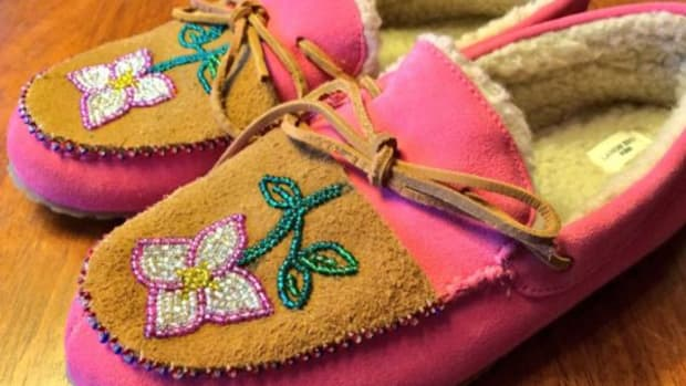 She sewed beaded moose skin on Land's End kids slippers.