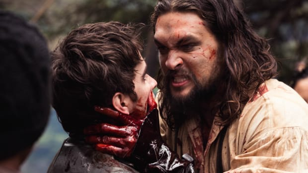 Michael Smyth (Landon Liboiron) held by the bloody hand of Declan Harp (Jason Momoa) in 'Frontier,' the six-episode, one-hour drama from Discovery Canada series which was shot in Newfoundland, Canada. Photo credit: Duncan de Young. CNW Group/Discovery