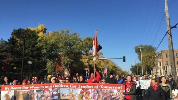 Protesters march down University Avenue in Minneapolis, Minnesota, on October 18  in protest of the Kansas City Chiefs. The team was in town to play the Minnesota Vikings.