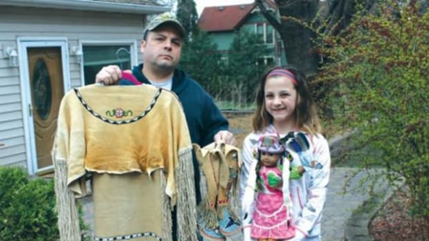 James Tom, left, of Oak Park Heights tanned a deer hide and sewed traditional garb for his daughter Natane.