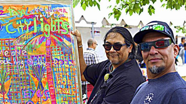 An Indian Market goer uses red and green lens glasses to look at 3D Indian art  by Ndn artist Ishkoten Dougi