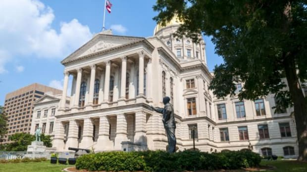 A Georgia Bill Would Exempt Construction Projects From Reporting Sacred Remains - Photo: The Georgia State Capitol in Atlanta, Georgia. The statue in the foreground is of Former Senator Richard B. Russell.