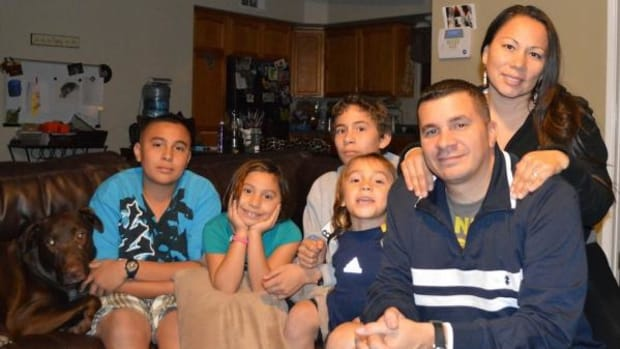 """Jeanne Eagle Bull-Oxendine and James Oxendine are shown here with their four children - Jase """"Maste"""", 5; Jada """"Sich"""", 7; Jake, 13; and Caske, 15. After taking a stand against their children's school's stereotype-laden Thanksgiving curriculum, the family says Jada's scholarship was revoked as retribution. School officials deny this."""
