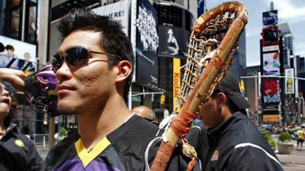 Bucktooth even carries his stick when walking through Times Square.
