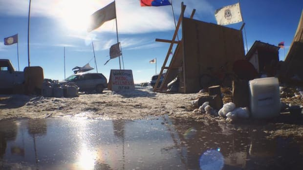 Warmer temperatures have started to melt near-record snowfall at the Oceti Sakowin camp. Water protectors have begun a mass cleanup of the site in preparation for spring flooding.
