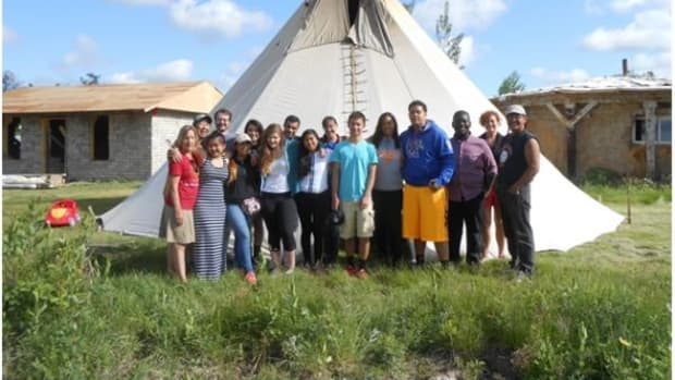 Earlier this summer, two group leaders, two teachers, and 11 high school students piled into a van at Rapid City Airport to spend a week at Pine Ridge to learn about the culture, study the factors contributing to such extreme poverty on the reservation, and examine the use of microfinance to promote economic growth and development.