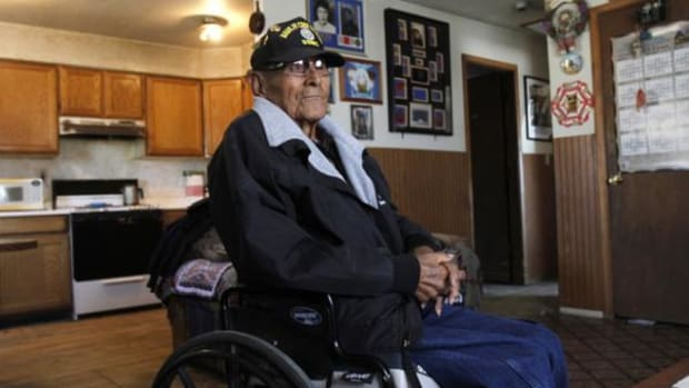 Navajo Code Talker Tom Jones is seen, Wednesday, November 14, 2013, during an interview at his home in Hogback, New Mexico. The Navajo Nation said Jones died Monday, May 12, 2014 at a Farmington hospital after a battle with pneumonia and other medical conditions. He was 89.