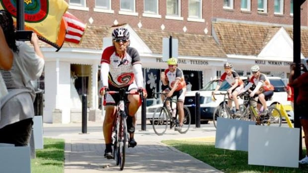 Remember the Removal Bike Ride Elder Ambassador and Cherokee Nation citizen Sammy Houseberg leads the cyclists to the Cherokee Nation Courthouse as they complete the 950-mile trek.
