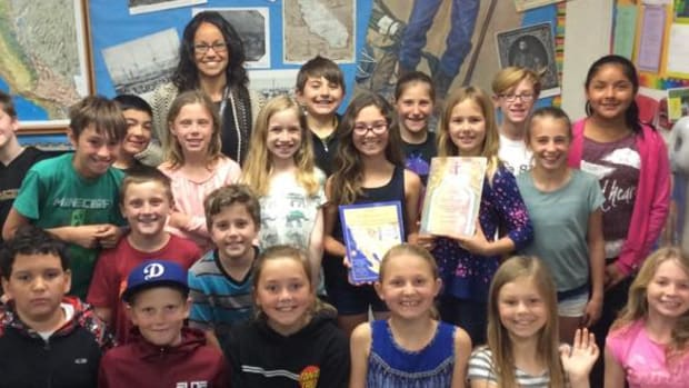Dessa Drake teaches elementary school children about missions and Native Americans in California.