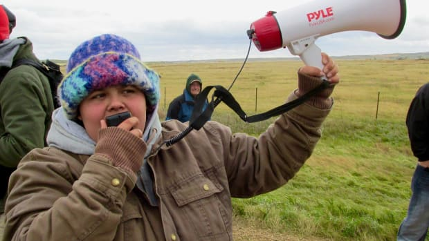 Caro Gonzales, above, speaks against the construction of the Dakota Access Pipeline near the Standing Rock reservation in North Dakota. More water protectors are needed as the Dakota Access Pipeline inches closer and closer to the Missouri River near Standing Rock.