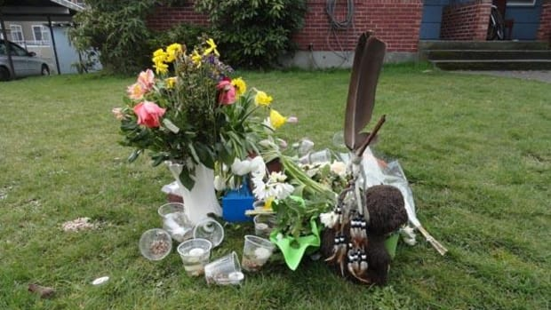A memorial sits where Jack Keewatinawin, a 21-year-old mentally ill Native man, was fatally shot by the Seattle Police Department following a response to a 911 call, that has a neighborhood raising questions about how the events unfolded.