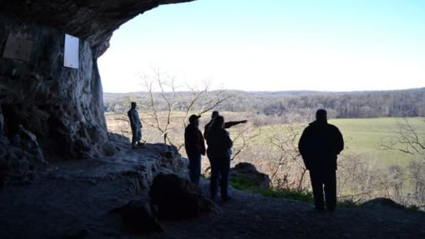 Joe Proffit, natural resources specialist, points to an area once settled by ancestral Osage people.