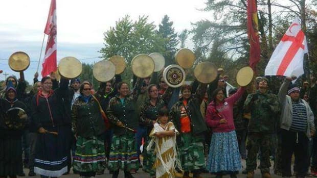 Mi'kmaq women face off against police in October 2013 while protesting fracking on the territory of Elsipogtog First Nation.