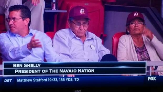 Redskins owner Dan Snyder sits in his box seats with Navajo Nation President Ben Shelly