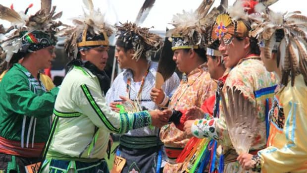 "Men Smoke dancers show good sportsmanship after dancing at the Seneca Nation's Marvin ""Joe"" Curry Veterans Pow Wow in Salamanca, N.Y., July 17-19, 2015."
