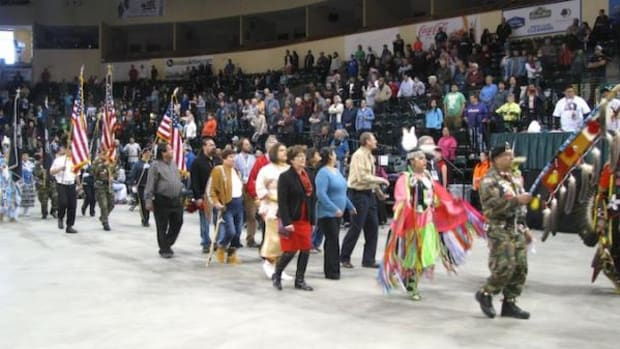 Tribal, state, and city officials dance in unity at the Bemijigamaag Powwow in Bemidji, Minnesota.