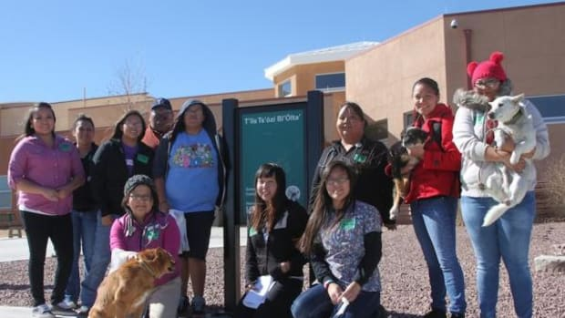 Members of Navajo Technical University's Pre Vet club pose for a picture outside of T'iis Ts'ozi Bi'Olta on February 14 after giving a presentation on being a responsible pet owner to kindergarten through third grade students.