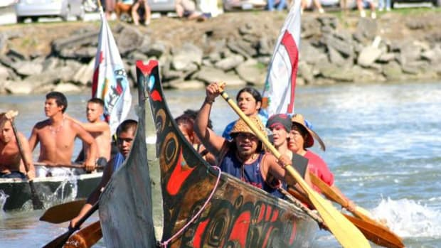 A Quileute Nation canoe arrives at Swinomish, during an canoe journey. Celebrate Quileute Days and honor the real history of the tribe.