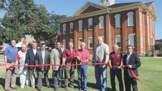 Cherokee Nation officials celebrate the restoration of the Cherokee National Capitol building, which was built in 1869, on September 20, 2015. Present were, from left: David Walkingstick, Cherokee Nation Tribal Council; Crosslin Smith, Cherokee spiritual leader; Rex Jordan, CNB board of directors; Chuck Hoskin Jr., Cherokee Nation secretary of state; Joe Byrd, speaker of the Cherokee Nation Tribal Council; Cherokee Nation Deputy Principal Chief S. Joe Crittenden; Cherokee Nation Principal Chief Bill John Baker; Shawn Slaton, CNB chief executive officer; Curtis Snell, Cherokee Nation Tribal Council; and Todd Hembree, Cherokee Nation attorney general.