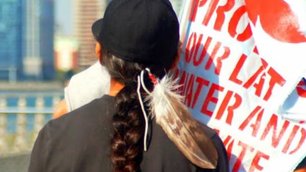 Brett Brings Plenty, 14, an Oglala Lakota youth, participates in the People's Climate March in New York City in September 2014. Tara Houska, Ojibwe, said Native American hair is sacred, and it is a Native American's religious right to wear it long.