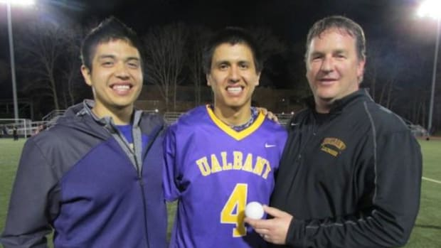 Miles (left) and Lyle Thompson with UAlbany coach Scott Marr.