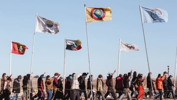 Water protectors at the Oceti Sakowin camp stand in unity against DAPL.