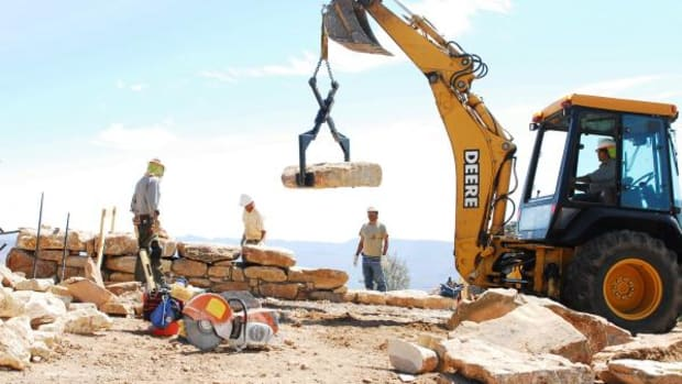 Crews repair a wall in the Grand Canyon National Park in this 2012 file photo. A new National Park Service report says the nation's parks had $11.9 billion in deferred maintenance last year, including a $371 million backlog at the Grand Canyon.