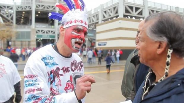 A Cleveland Indians fan confronts Robert Roche, right, Chiricahua Apache, outside Progressive Field in Cleveland, Ohio, in 2014.