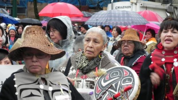 Bernie Williams and Reta Bird were among elders that led the memorial march to Oppenheimer Park where they held a candlelight vigil at a totem pole carved in honor of 600 murdered and missing Native women.