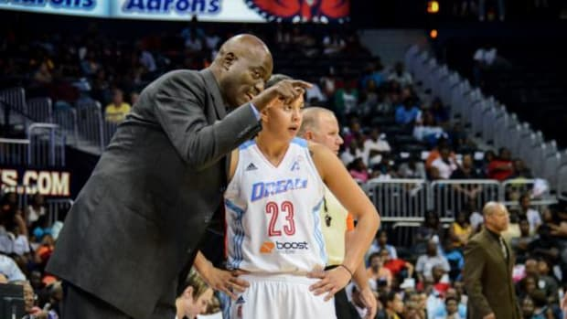 Head Coach of the Atlanta Dream Michael Cooper coaches rookie Shoni Schimmel during the 2014 season. Cooper has compared Schimmel to former LA Lakers star Magic Johnson.