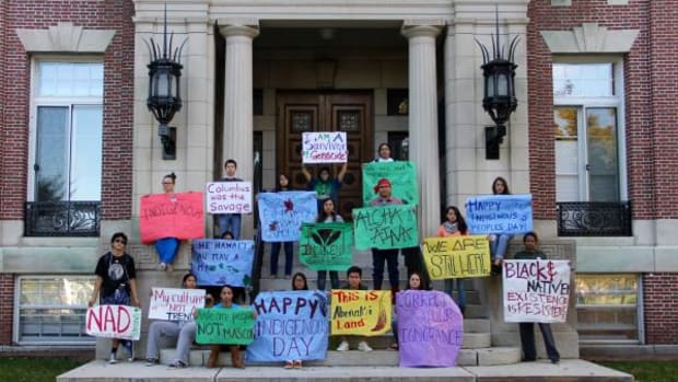 Native students at Dartmouth College made a number of signs to protest Columbus Day and celebrate Indigenous Peoples' Day, but fliers appeared that brought back the old Indian mascot.