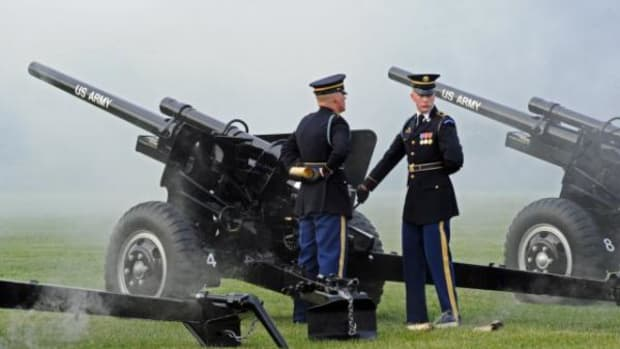 Soldiers with 3d U.S. Infantry Regiment (The Old Guard) Presidential Salute Battery prepare to fire a 75mm blank shell at a Twilight Tattoo ceremony recognizing the 238th Army Birthday, which is June 14, 2013.