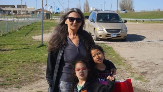 Candace Ducheneaux and two of her grandchildren outside a playground in Eagle Butte, South Dakota.