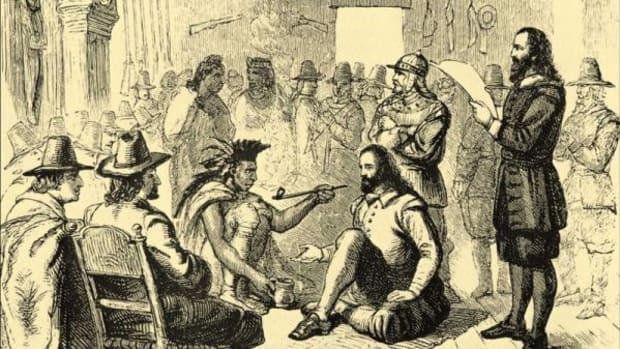 Massasoit and governor John Carver smoking a peace pipe in Plymouth in 1621.